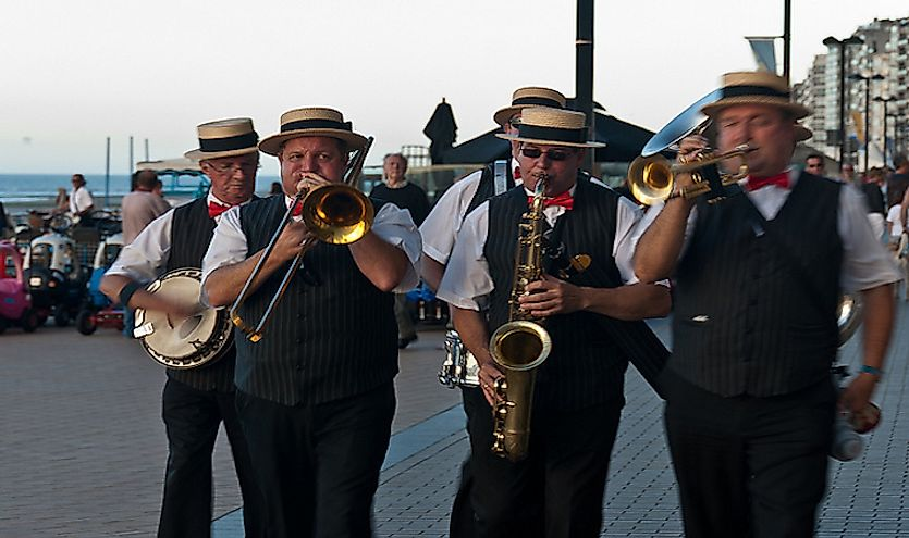 Jazz music being played by a walking group of musicians.