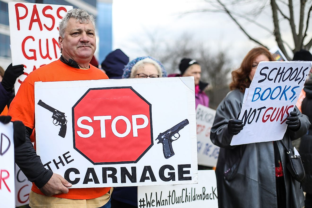 Protesters gather outside of the National Rifle Association headquarters for a vigil in remembrance of the 2012 Sandy Hook Elementary School massacre in Newtown. Image credit:  Nicole Glass Photography/Shutterstock.com