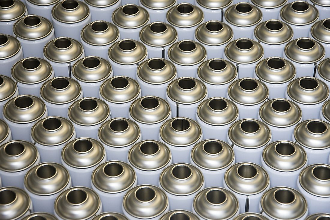 Rows of empty aerosol cans.