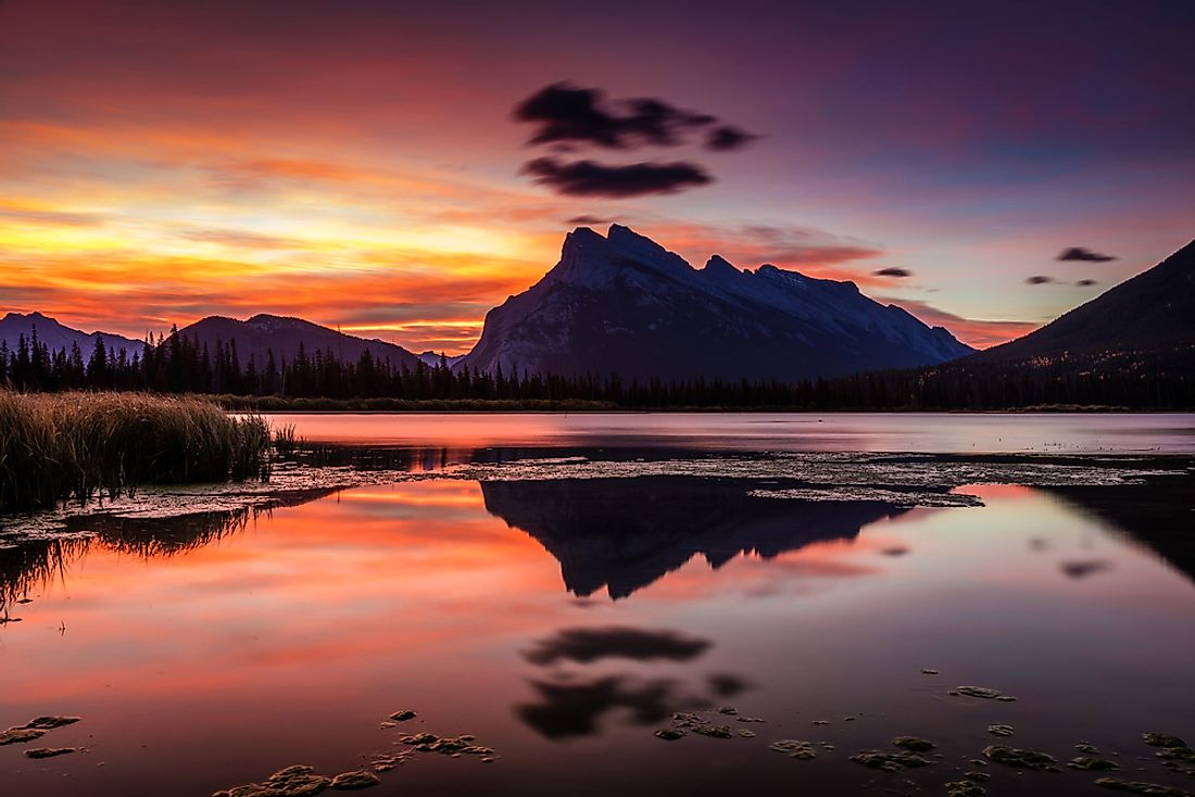 The rising sun heralds a new day over the Vermillion Lakes in Alberta, Canada's Banff National Park.