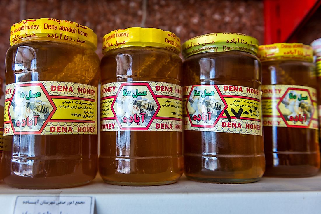 Honey on the shelf of a grocery store in Iran. Honey is consumed all over the world. Editorial credit: Fotokon / Shutterstock.com.