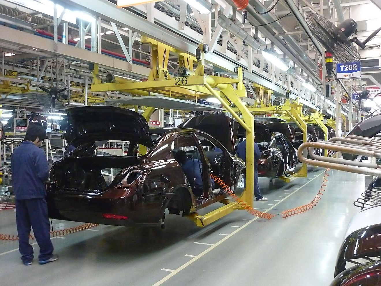 A car being assembled in a motor-vehicle factory.