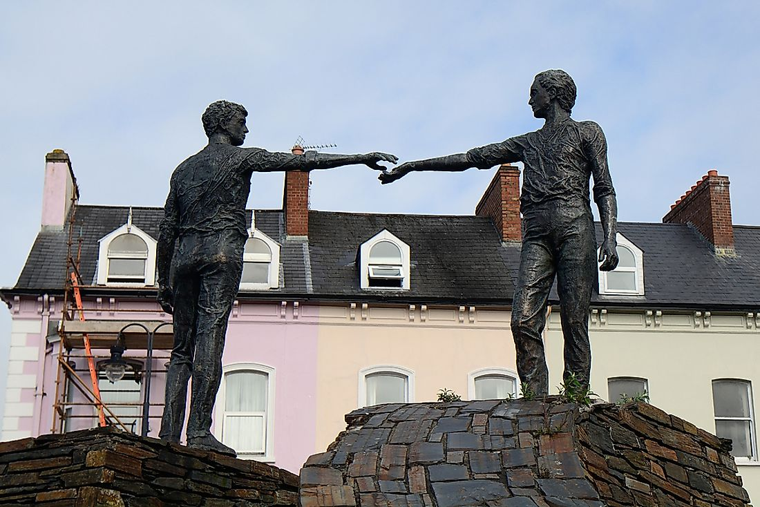 The Hands Across the Divide monument in Derry, Northern Ireland was erected 20 years after Bloody Sunday. Editorial credit: Attila JANDI / Shutterstock.com