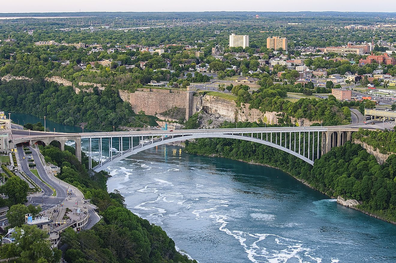 Rainbow Bridge above Niagara River Gorge from American side near Niagara Falls. It is an arch bridge between the United States of America and Canada. Image credit: Pit Stock/Shutterstock.com