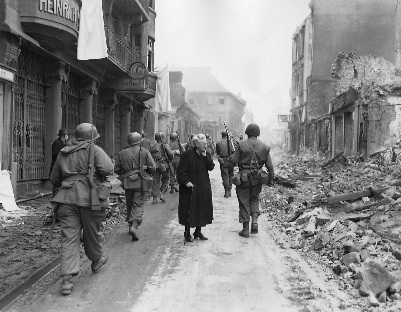 Infantrymen march through a German town at the end of WWII. Image credit: Everett Collection/Shutterstock