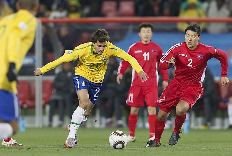 Team Brazil dukes it out with Team North Korea in international competition at the FIFA World Cup.