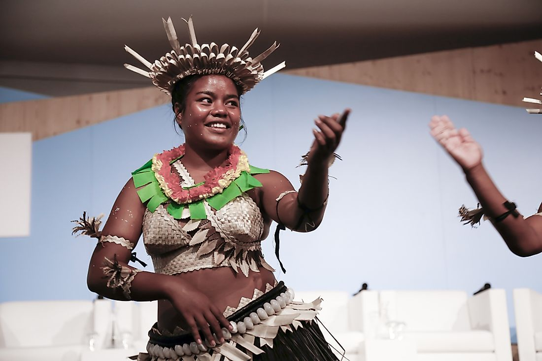 A dancer from Kiribati performs at the UN Convention for Climate Change. Editorial credit: dominika zarzycka / Shutterstock.com.