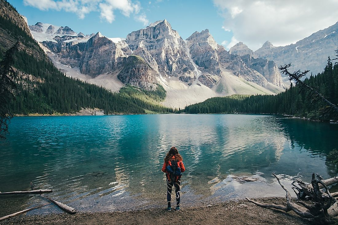 A backpacker admires the sights of Moraine Lake in Alberta, Canada.