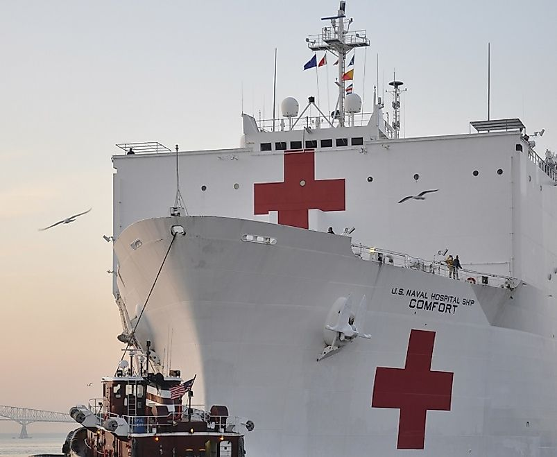 The USNS Comfort, a hospital and humanitarian aid ship displaying the Red Cross emblem upon its hull in Baltimore Harbor in the U.S. state of Maryland.
