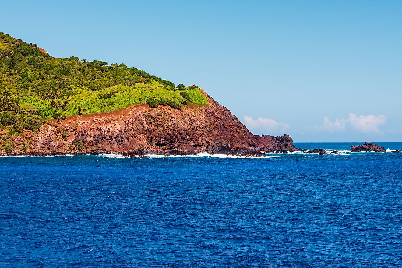 Photo of Pitcairn Island in Bounty Bay--so called becuase it was inhabited by 9 mutineers from Mutiny on the Bounty. Image credit: Joe Benning/Shutterstock.com