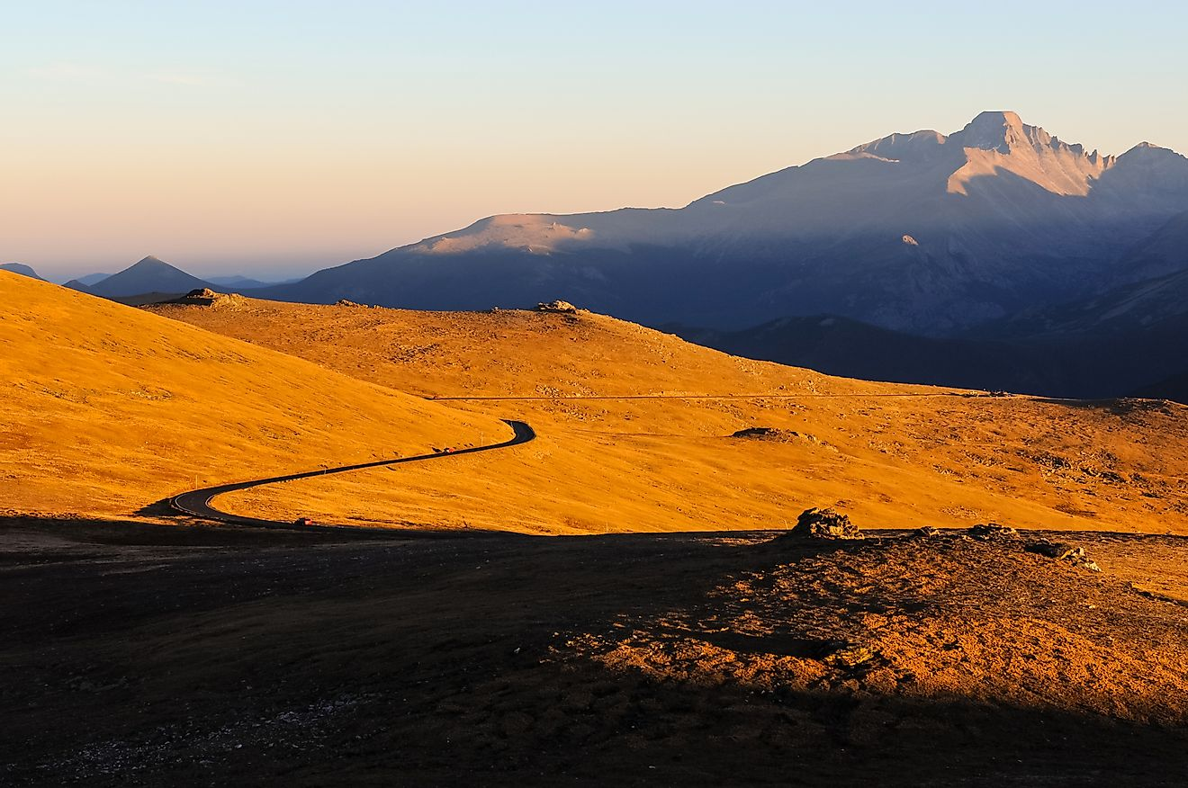 The setting of the autumn sun along Colorado's Trail Ridge Road, where the semi-arid foothills rapidly give way to the heights of the Rocky Mountains.