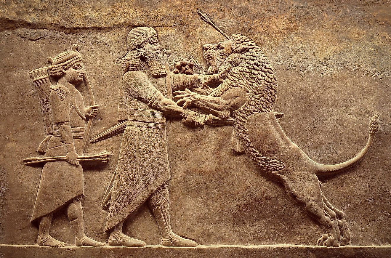 Assyrian wall relief, detail of panorama with royal lion hunt. Old carving from the Middle East history. Remains of culture of Mesopotamia ancient civilization. Image credit: Viacheslav Lopatin/Shutterstock.com