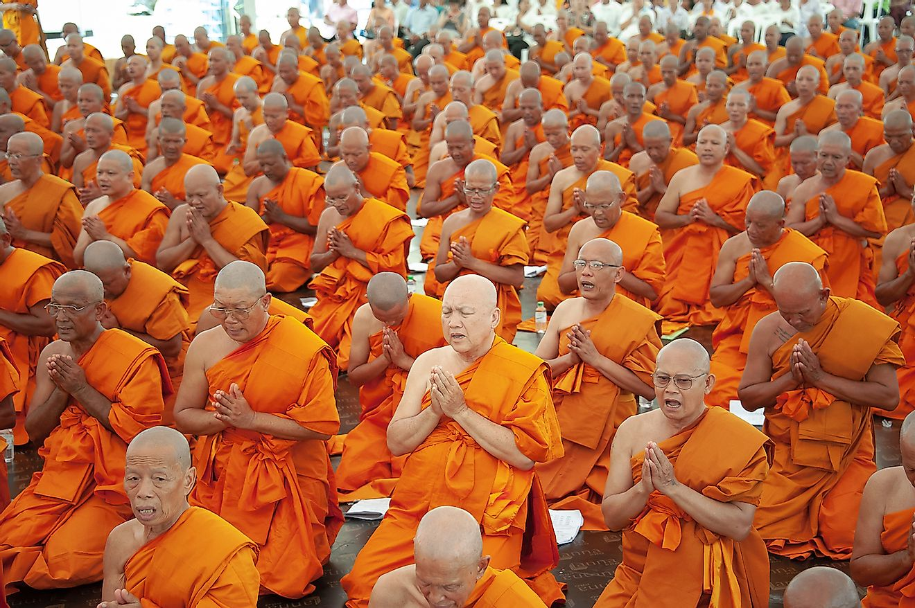 Buddhists monks pray in Bangkok, Thailand. Image credit: PhaiApirom/Shutterstock.com
