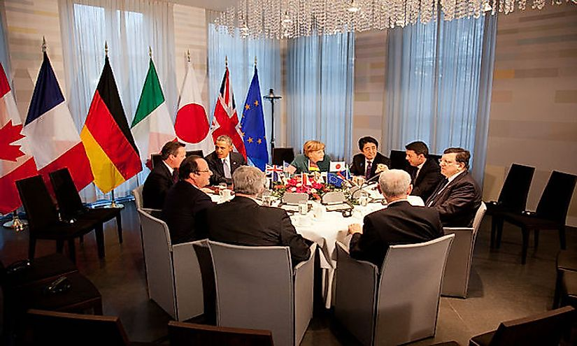 Discussion between representatives of G7 countries in a G7 summit.