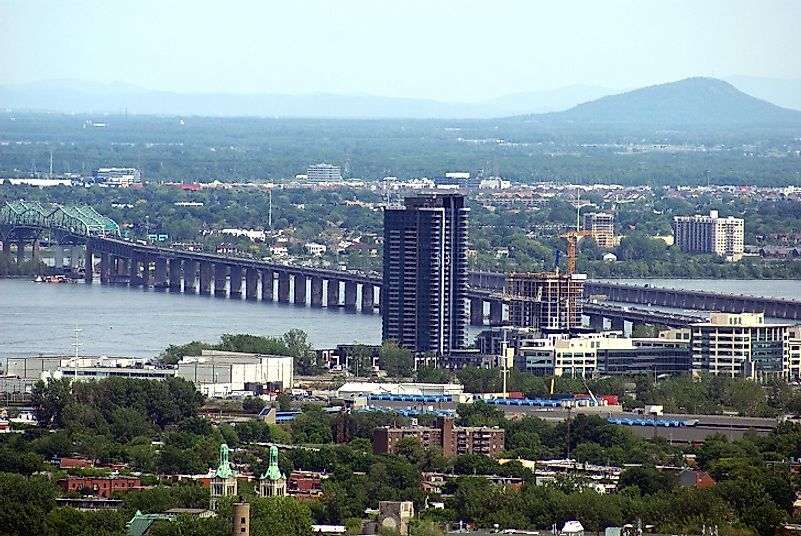 The Saint Lawrence River passing under a bridge in the city of Montreal, Quebec, Canada.
