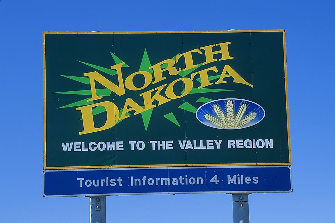 A sign welcoming visitors to North Dakota.