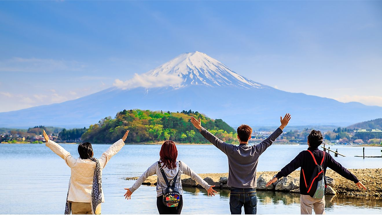 Tourists enjoying the sight of Mount Fuji in Japan, one of the world's safest countries.