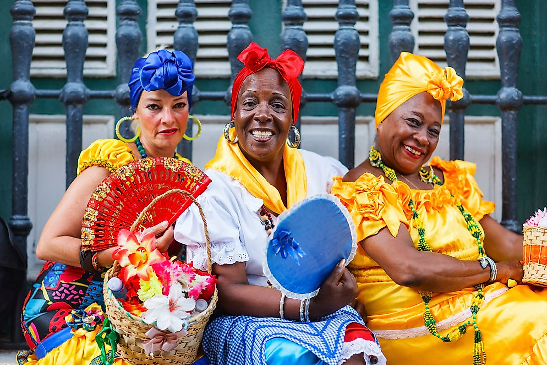 Women pose for a photo in Havana, Cuba. Editorial credit: BlueOrange Studio / Shutterstock.com.