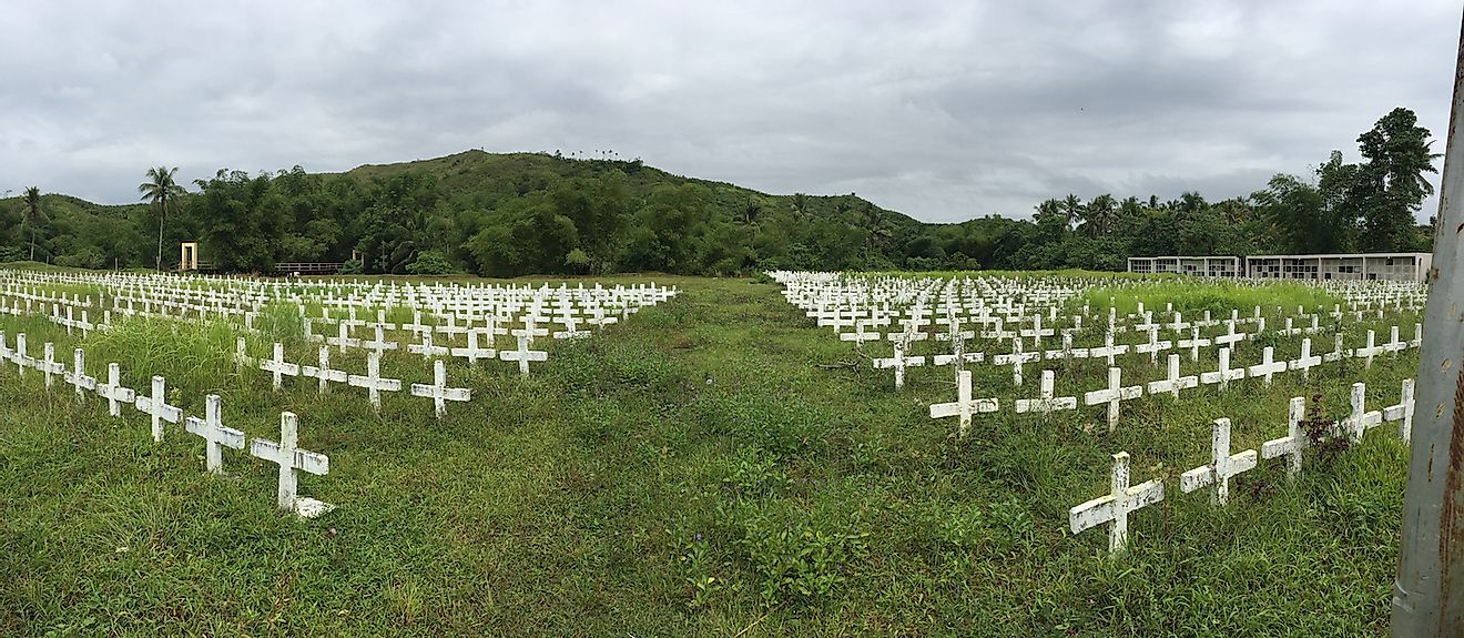 The Holy Cross Memorial Park in Tacloban City, Philippines, is a common grave to the thousands who died during the inslaught of typhoon Yolanda, or also known as Haiyan. Image credit: Lito_lakwatsero/Shutterstock.com