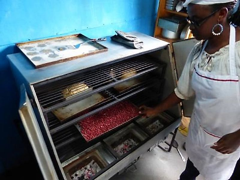 A South Sudanese baker uses a biomass-fueled stove financed in part by a nongovernmental organization.