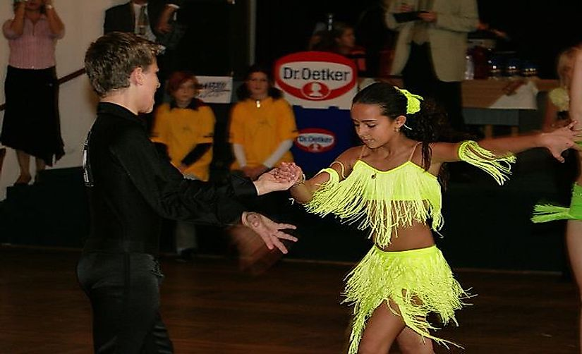 A Cha-cha dancing pair at a junior ballroom dance competition in Tuchlovice, Czech Republic.