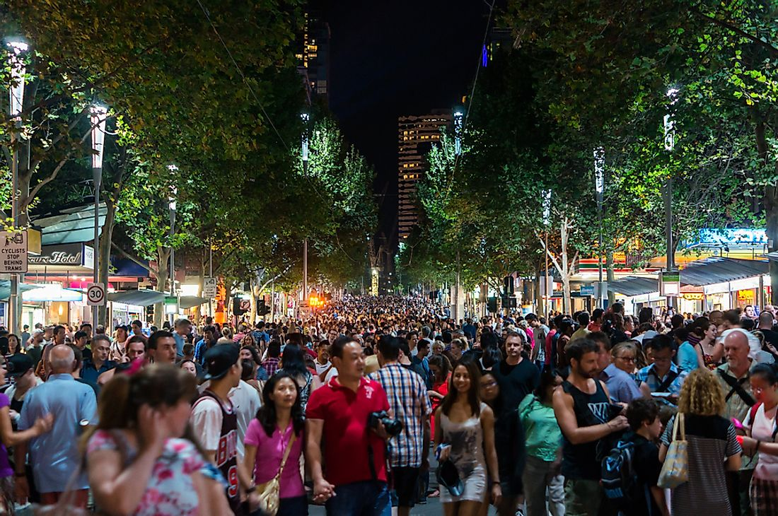 A crowd of people walk in Melbourne, Australia. Australia is a multicultural country. Editorial credit: Nils Versemann / Shutterstock.com.