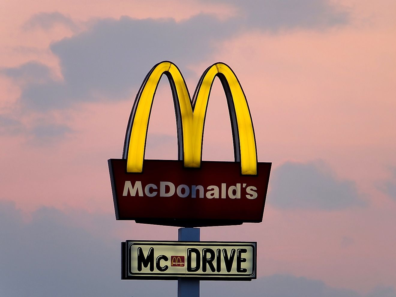 Neon of Mc Donald's in Szczecin, Poland. Mc Donald's is the largest and the most popular restaurant chain in Poland. Image credit:  siekierski.photo/Shutterstock.com