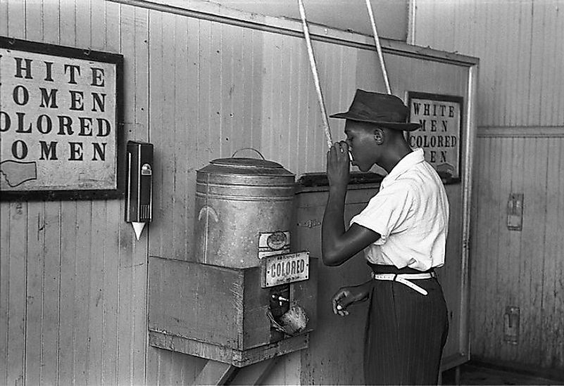 An African-American man at a segregated restroom and drinking fountain in Oklahoma City in the Summer of  1939.