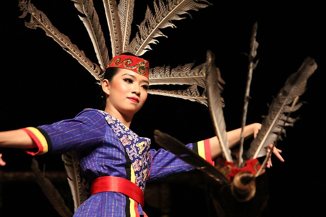 A dancer in a Javanese dance performance. Editorial credit: tirtaperwitasari / Shutterstock.com.