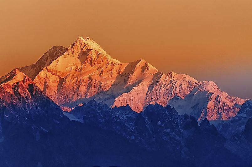 The sun rises over the icy slopes of Kangchenjunga in the state of Sikkim, India.