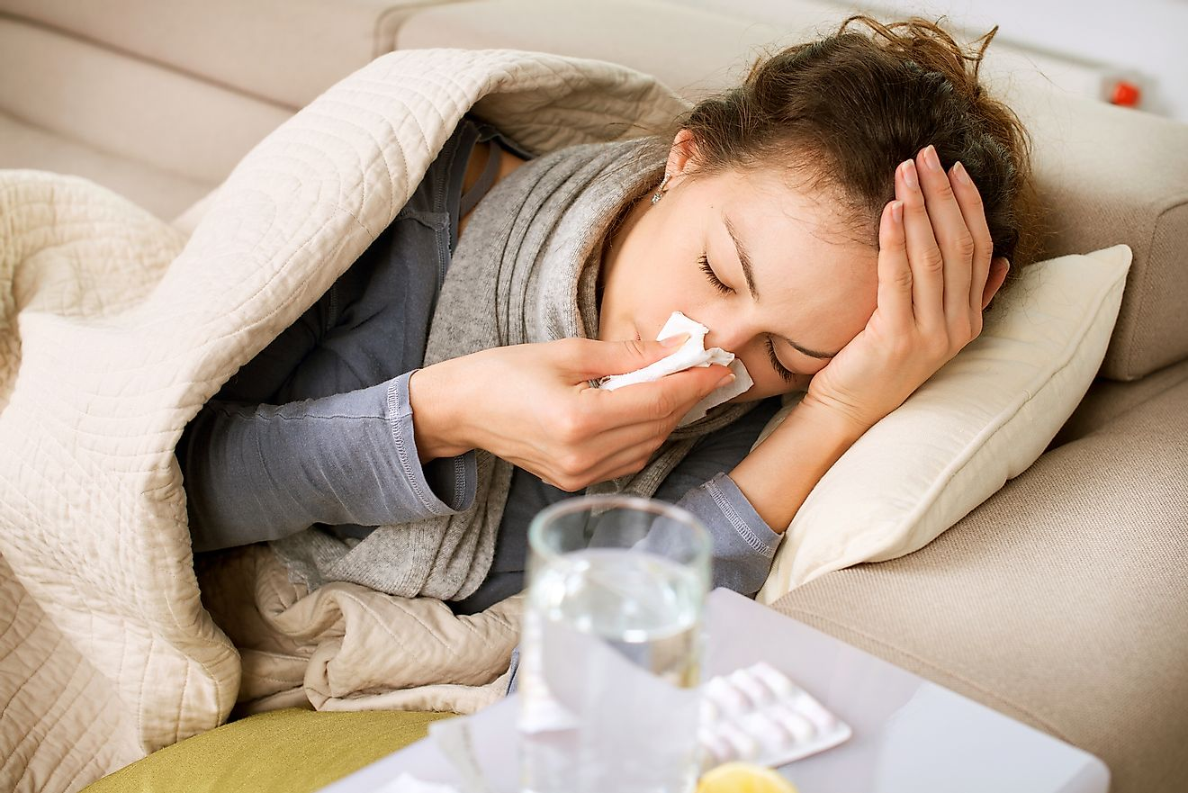 A sick woman suffering from cold and fever.