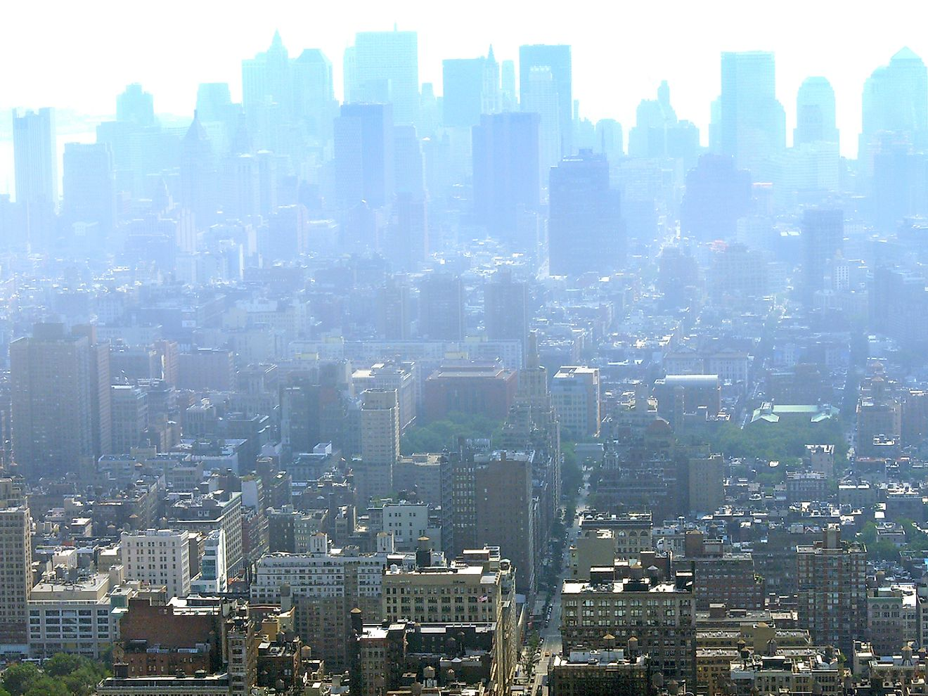 Manhattan's skyscrapers disappearing in the distance under a heavy blanket of smog and haze due to pollution. Image credit: KishoreJ/Shutterstock.com