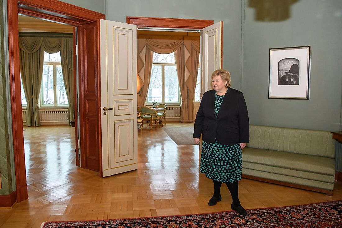 Norwegian prime minister Erna Soiberg stands in her residence in Oslo, Norway. Editorial credit: paparazzza / Shutterstock.com.
