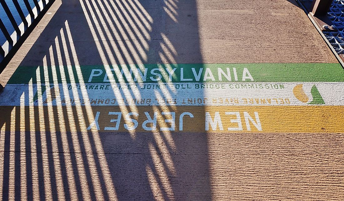 Boundary line between New Jersey and Pennsylvania on a bridge spanning the Delaware River.  Editorial credit: EQRoy / Shutterstock.com