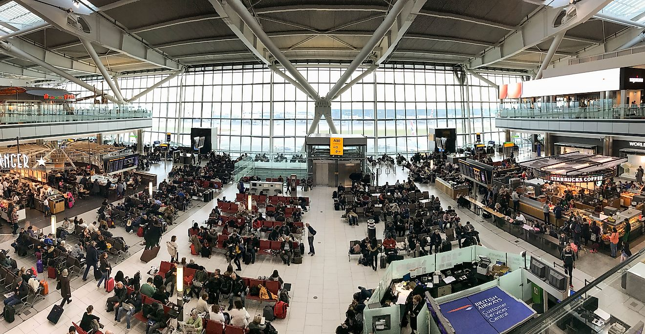 Passengers waiting at the Heathrow Airport, United Kingdom. It is the world's 7th busiest airport. Editorial credit: Ceri Breeze / Shutterstock.com