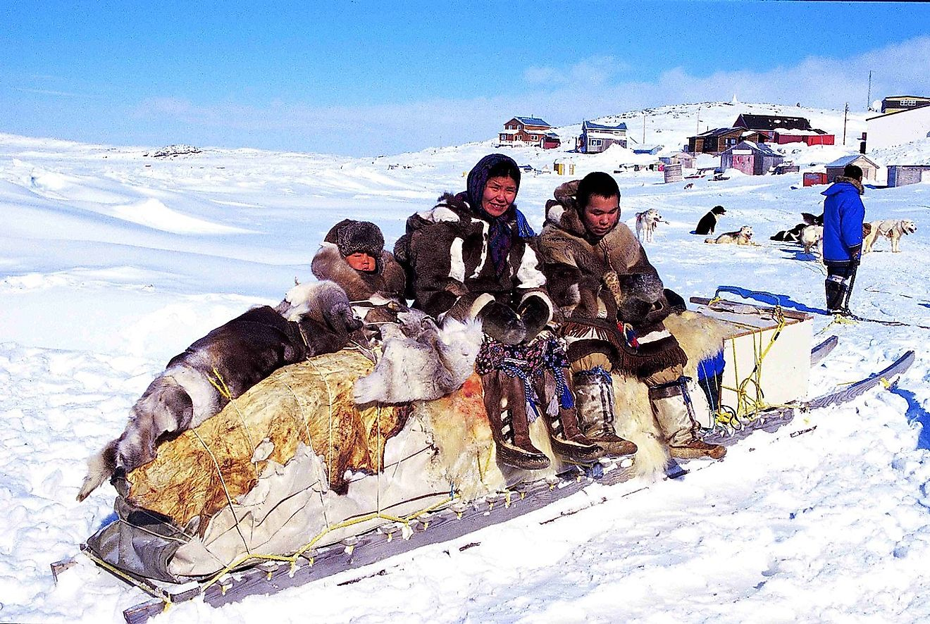 A Innuit family in a their traditional village in Cape Dorset, Nunvavut, Canada. Image credit: Ansgar Walk/Wikimedia.org