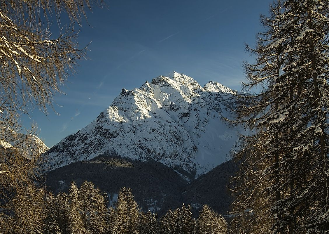 Piz Pisoc, extending upwards to reach almost two miles above sea level, is the highest peak in the Swiss National Park.