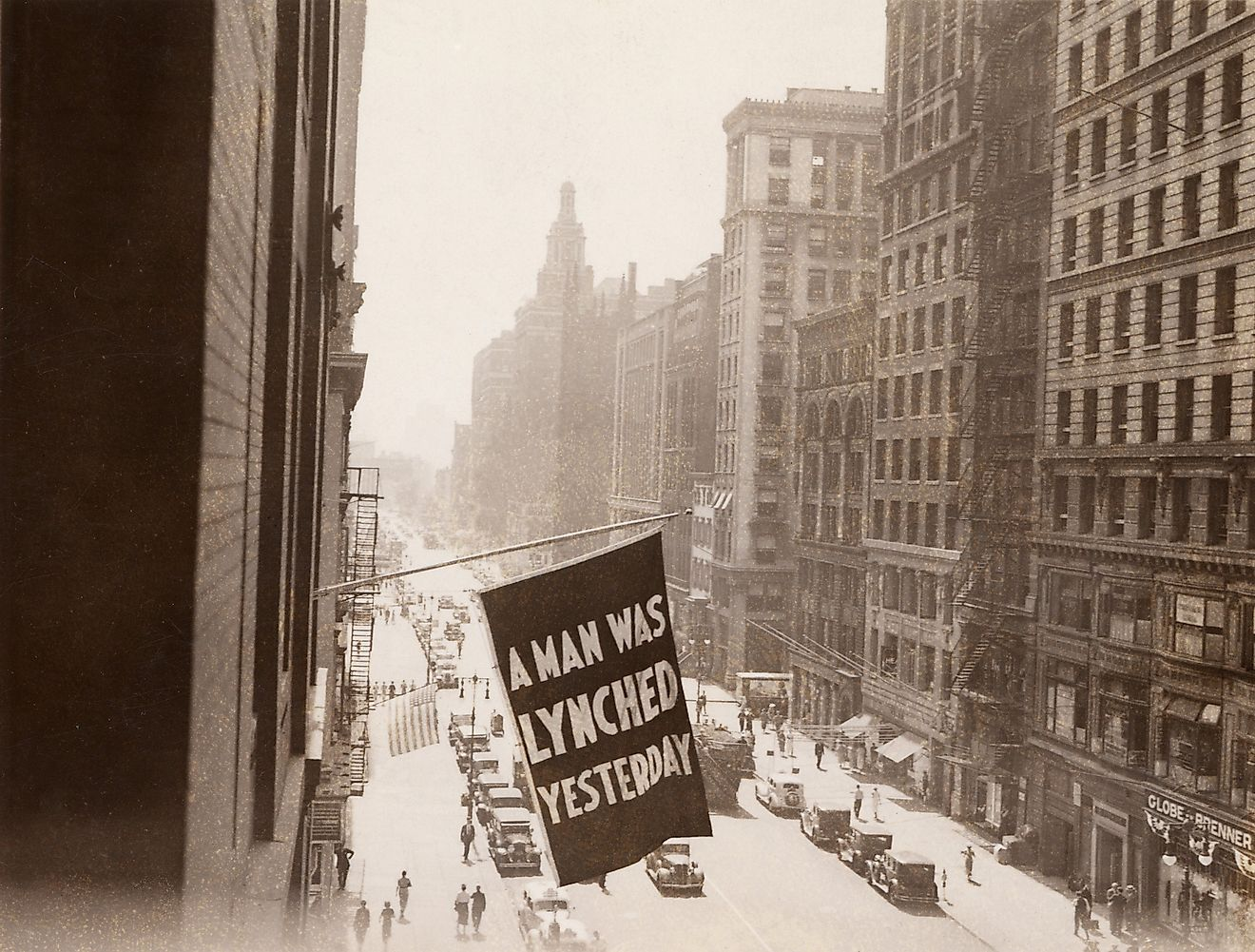 'A MAN WAS LYNCHED YESTERDAY,' is flown from the window of the NAACP headquarters on 69 Fifth Ave., New York City in 1936.Image credit: Everett Collection / Shutterstock.com