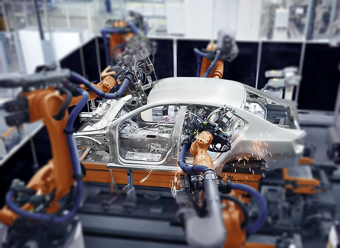 A car being manufactured on an assembly line.
