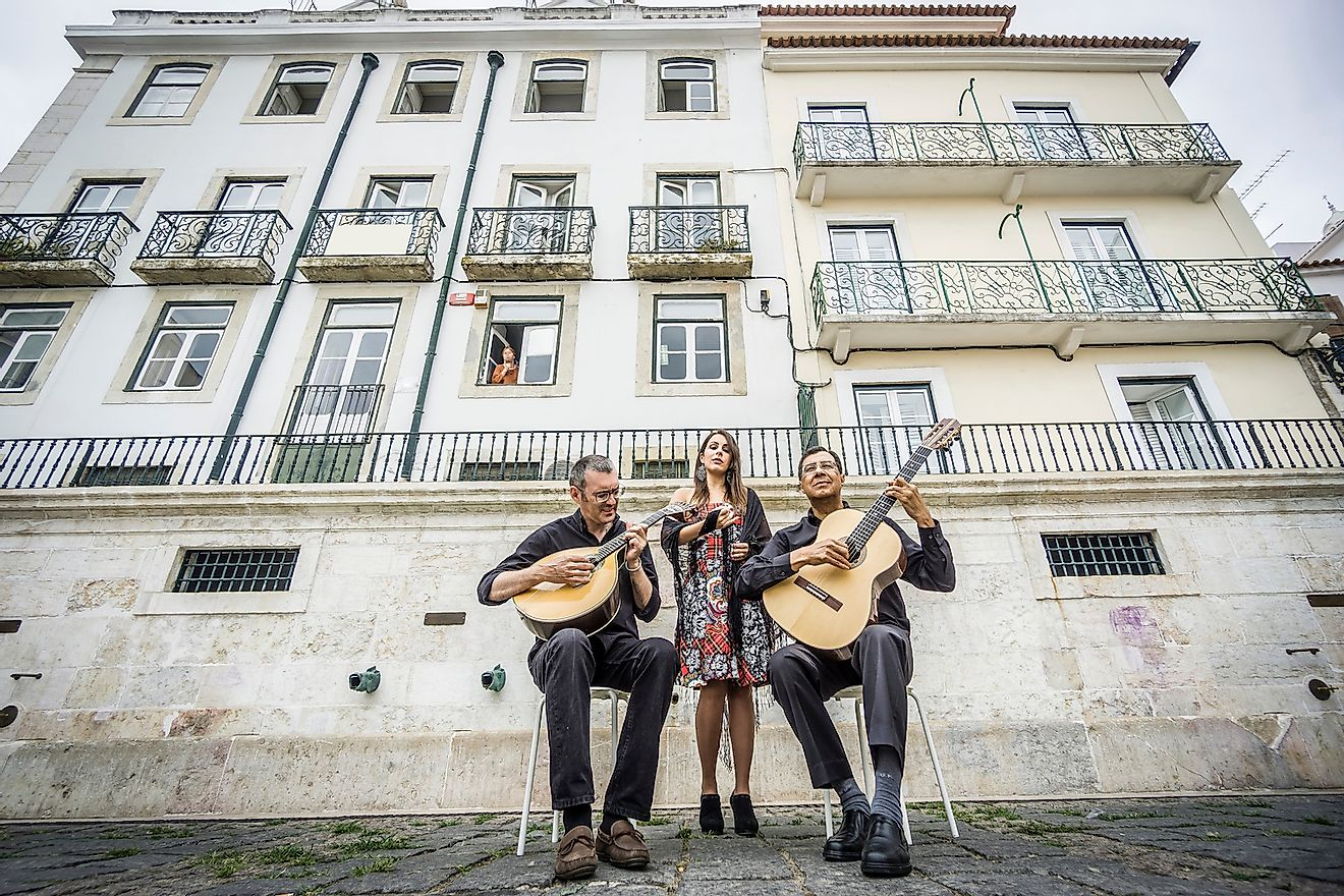 Fado band performing traditional Portuguese music on the square of Alfama, Lisbon, Portugal. Image credit: Sopotnicki/Shutterstock.com