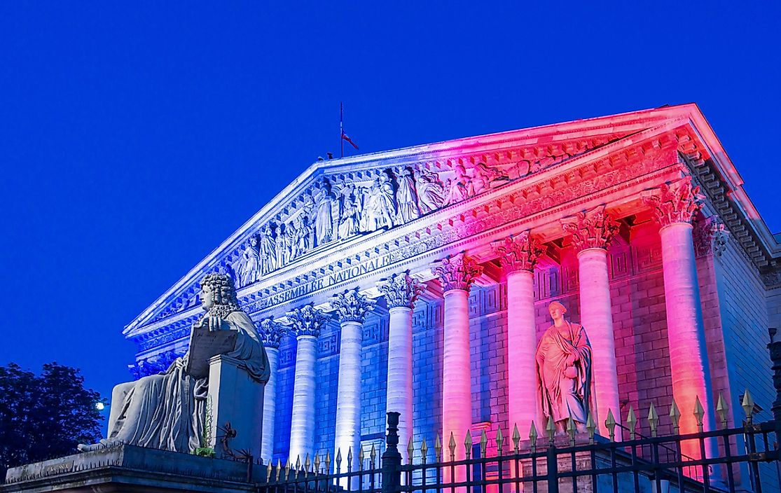 The National Assembly in France lit up in the colors of the French flag.