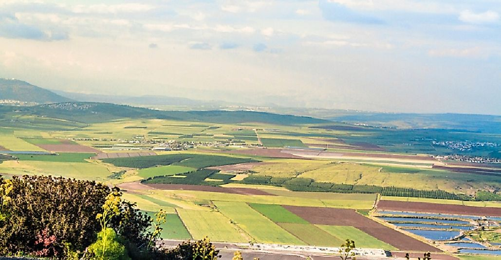 Vast expanses of fertile farmlands stretch out in the Jezreel Valley below the Samarian Highlands.