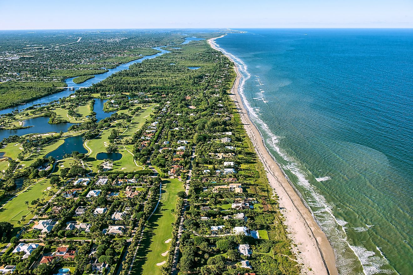 Jupiter and Hobe Sound, Florida, along the Atlantic Ocean coast, lined by the beach and dotted by luxury homes golf courses. Image credit: FloridaStock/Shutterstock.com