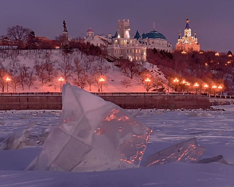Khabarovsk, Russia at Christmastime, as seen from the frozen Amur River running beside it.