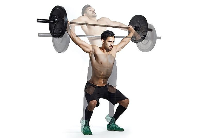 A man performs a Snatch, currently one of the two competitive lifts, alongside the Clean and Jerk.