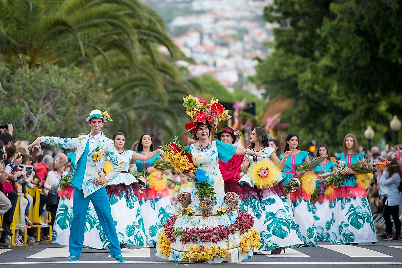 The Portuguese celebrating the annual Festa da Flor or Spring Flower Festival in the city of Funchal on the Island of Madeira in Portugal. Image credit: amnat30/Shutterstock.com