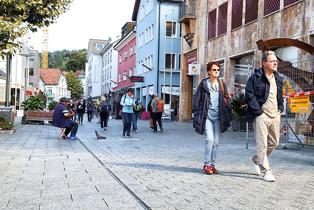 People walk in Vaduz, Liechtenstein. Editorial credit: KELENY / Shutterstock.com.