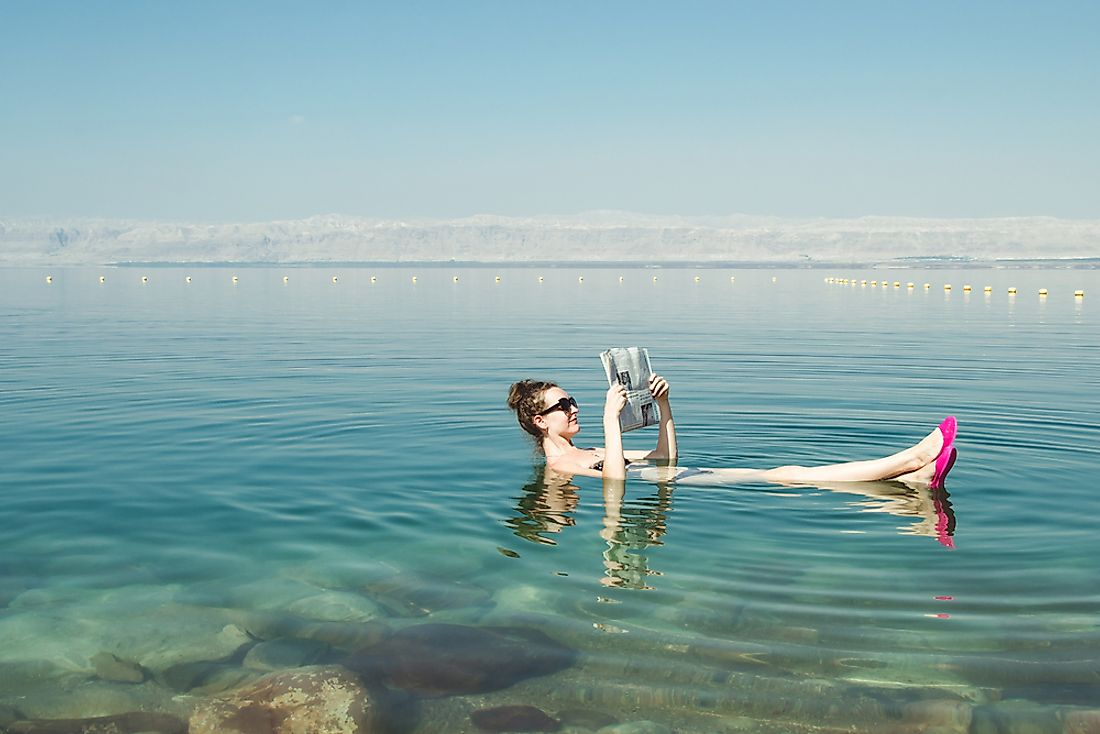 The Dead Sea's high salt content allows one to float effortlessly on the water.