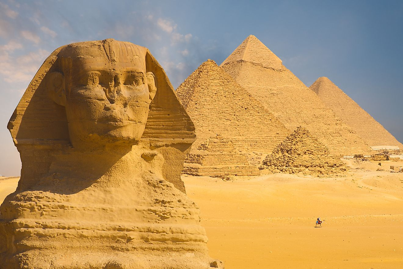 The Great Sphinx of Giza with the Pyramid of Menkaure in the background in Cairo, Egypt.