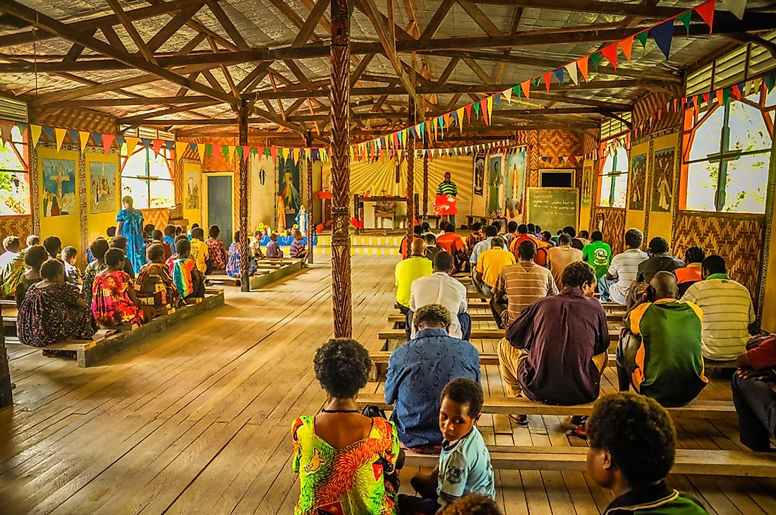 Community members attending mass at a church in Papua New Guinea. Editorial credit: Michal Knitl / Shutterstock.com